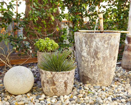 Water fountain and succulents in xeriscape garden