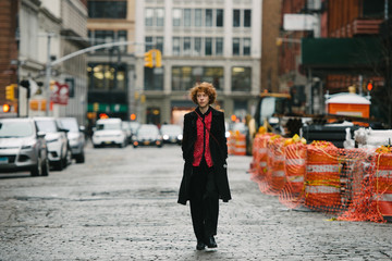 Young woman walking in city