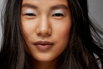 New Beauty - Beautiful young asian woman makeup portrait in studio