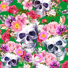 Human skulls with flowers, feathers for Day of Death or Halloween. Seamless pattern on green background. Watercolor