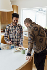 Male Gay Couple Preparing and Having Breakfast Together
