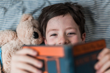 Reading stories to teddy bear