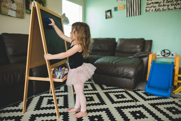 Erasing the chalkboard in a tutu