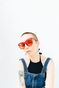 Woman with buzz cut looking at camera