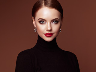 Beautiful Young Woman with Clean Fresh Skin. Perfect Makeup. Beauty Fashion. Red Lips. Cosmetic Eyeshadow. Smooth Hair. Girl in Black Turtleneck