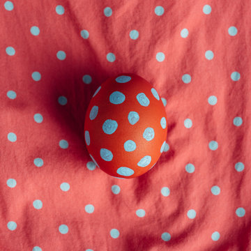 Polka dot egg on a matching pattern material
