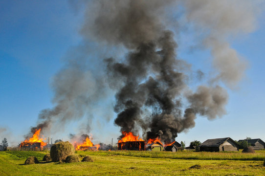 The fire in the village. Burning wooden huts and houses.