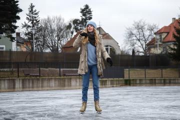 Pretty woman on skating rink