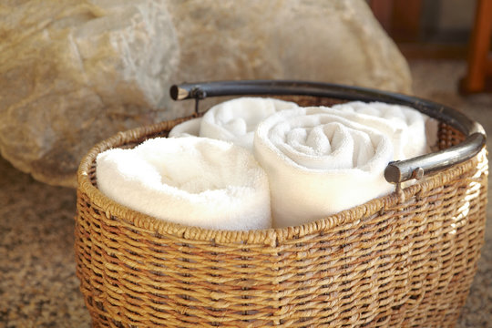 Towels in a woven basket at spa