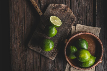 Fresh lime on wood board, bio fruit