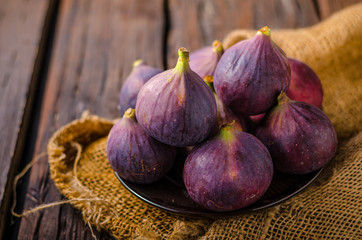 Fresh figs on wood board