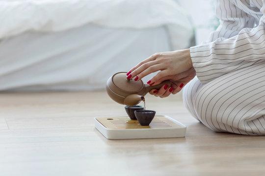 Woman Making a Tea