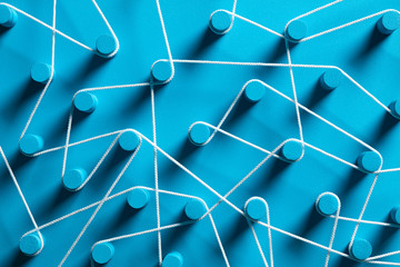 Blue pins connected by white string.