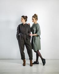 Two pretty women posing in studio