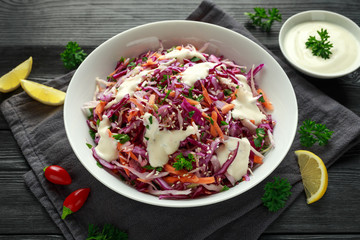Coleslaw salad with red, white cabbage, carrot, parsley, sesame seeds. served with mayonnaise and lemon