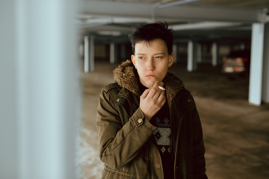 Real lesbian girl smoking on the parking area