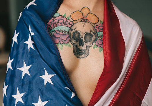 young woman with tattoo and usa flag
