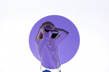 Woman with projection of violet circle