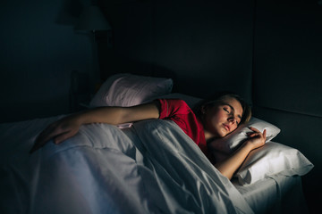 Woman Sleeping at night With Red Sleepwear