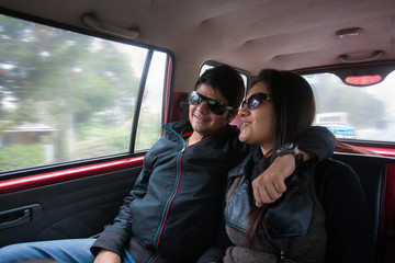 A young couple enjoying an intimate moment in the taxi