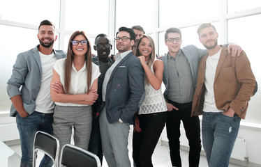 portrait of a professional business team standing in a modern office