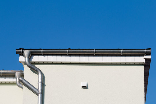Gutter at a house in front of blue sky