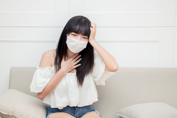 Woman suffer from cough with face mask protection.