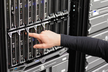Male IT Engineer Installing Blade Server In SAN At Datacenter