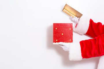 Santa claus holding a red present box on a white background