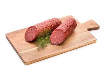 Salami smoked sausage, basil leaves on white background cutout.