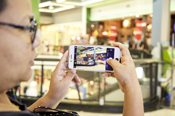 Woman Using smartphone in department store