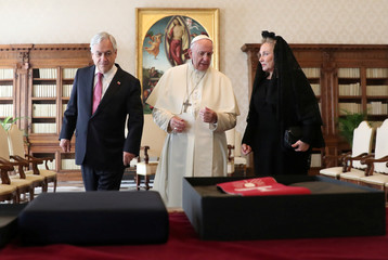 Pope Francis speaks as he meets with Chile's President Sebastian Pinera and his wife Cecilia Morel during a private audience at the Vatican