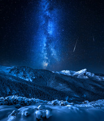 Cold Tatra Mountains with milky way and falling stars, Poland