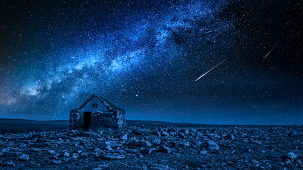 Fototapete - Small stone cottage and milky way with falling stars, Iceland