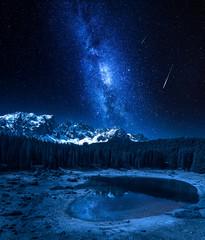 Fototapete - Milky way and falling stars over Carezza lake, Dolomites, Italy