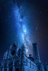 Fototapete - Siena Cathedral at night with falling stars, Tuscany, Italy