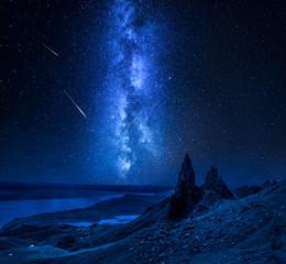 Fototapete - Milky way, falling stars over Old Man of Storr, Scotland