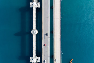 Aerial top view drone shot of bridge with cars on bridge road image transportation background concept