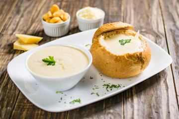 Homemade cheese cream soup, served in bread bowl