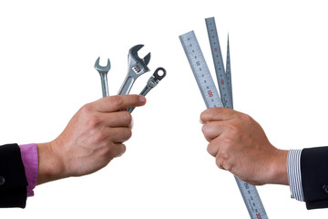 Two Mechanic engineers holding two ratchet box end wrench and open end wrench in his hand and other one holding ruler and scale; handing tool on white background with clipping path