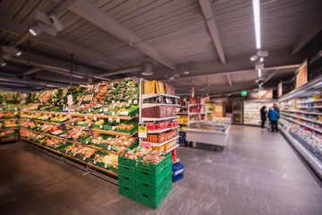 people shopping in modern supermarket
