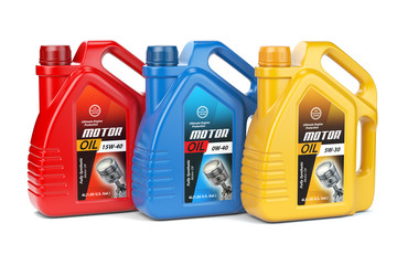 Motor oil canisters with different types of motor oil on white isolated background.