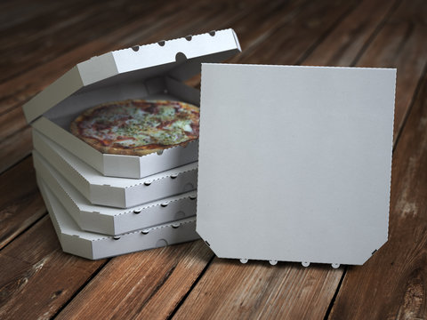 Pizza boxes on vintage wooden planks. Mock up.