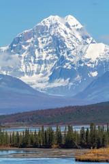 Snowy Mount Deborah stands overlooking the Susitna River where the Denali Highway crosses