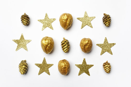 Christmas composition. christmas golden decorations on light background. Top view, flat lay