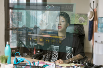 Professional Woman Operating a Futuristic Computer Media Screen