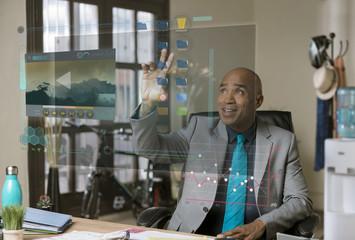 Smiling Professional Man Selecting Folder a Futuristic Computer Screen
