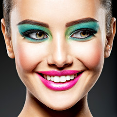 Face of a beautiful smiling girl with fashion make-up