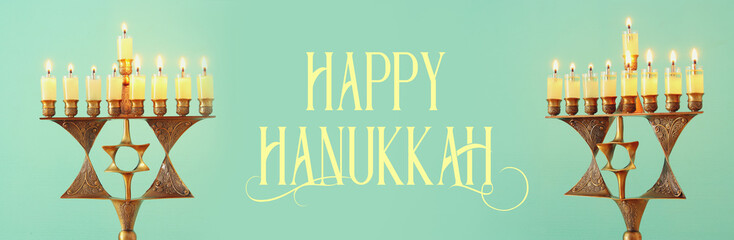 Banner of jewish holiday Hanukkah background with menorah (traditional candelabra) and burning candles.