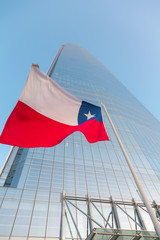 View of the Chilean flag in the background of skyscraper
